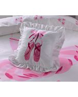 Pink ballet slippers with ribbons are embroidered on a beautiful cushion and surrounded by ruffles.